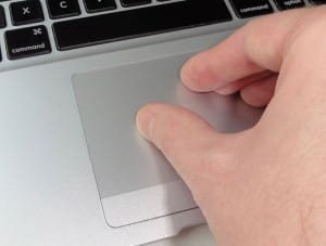 Four-finger pinch on the Mac trackpad