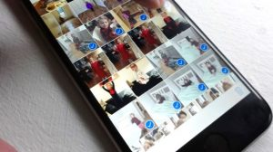 select all - Select two batches of pictures in iOS Photos app with a swipe