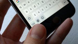 iOS keyboard globe key
